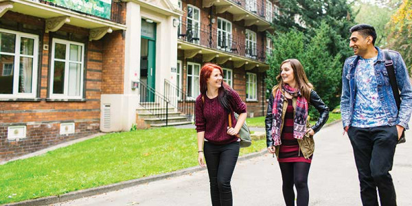 Students walking outside North Hill court university of leeds student accommodation